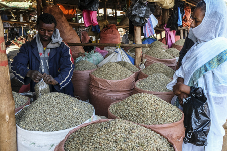 Bahir Dar, Amhara Region, Ethiopia - January 20: Unidentified man selling coffee beans at the market on January 20, 2018 in Bahir Dar, Ethiopia.