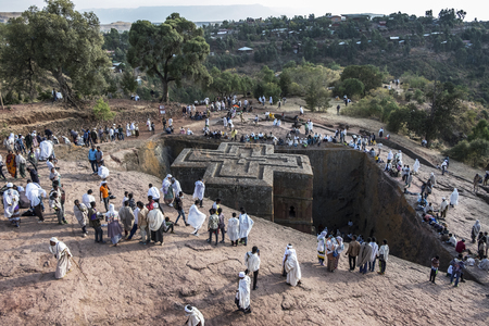 Lalibela, Ethiopia - January 5: Pilgrims at Bet Giyorgis, one of the rock churches in Lalibela and UNESCO World Heritage site on January 5, 2018 in Lalibela, Ethiopia