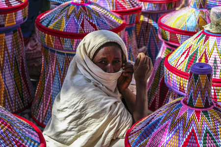 Aksum, Ethiopia - January 13: Ethiopian woman selling baskets in the Aksum basket market on January 13, 2018 in Aksum, Ethiopia. Editorial