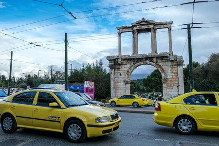 Athens, Greece - December 28: Cars circulating in front of Hadrian arch on December 28, 2017 in Athens, Greece.