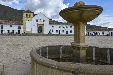 Villa De Leyva, Colombia - August 12: People in the Plaza Mayor, largest public square in Colombia on August 12, 2017 in colonial town of Villa de Leyva, Colombia. Editorial