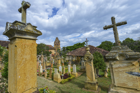 Barichara, Colombia - August 11: Tombstones in the cemetery, contains many ornate gravestones in yellow stone that is available in plenty in the local area on August 11, 2017 in Barichara, Colombia.