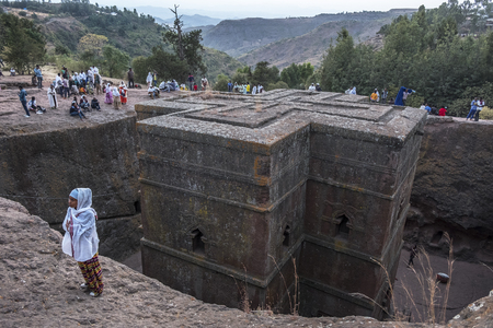 Lalibela, Ethiopia - January 5: Pilgrims at Bet Giyorgis, one of the rock churches in Lalibela and UNESCO World Heritage site on January 5, 2018 in Lalibela, Ethiopia