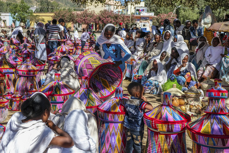Aksum, Ethiopia - January 13: Ethiopian women selling baskets in the Aksum basket market on January 13, 2018 in Aksum, Ethiopia. Editorial