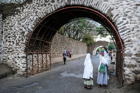 Gondar, Ethiopia - January 17: Two Ethiopian women talking on a street on January 17, 2018 in Gondar, Ethiopia.