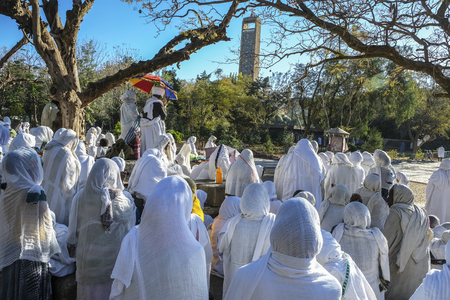 Aksum, Ethiopia - January 13: Orthodox Christian pilgrims attend an open-air service at the St Mary of Zion church on January 13, 2018 in Aksum, Ethiopia.