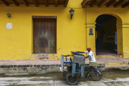 Mompox, Colombia - August 8: An unidentified man on a tricycle down a street on August 8, 2017 in Mompox, Colombia.