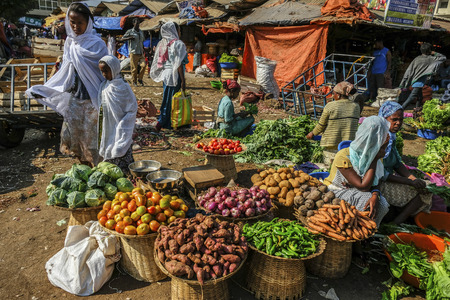 Bahir Dar, Amhara Region, Ethiopia - January 20: African woman selling vegetable products in the market on January 20, 2018 in Bahir Dar, Ethiopia.
