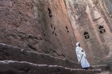Lalibela, Ethiopia - January 6: Portrait of an unidentified woman in Bet Mikael, one of the churches excavated in the rock of Lalibela on January 6, 2018 in Lalibela, Ethiopia.