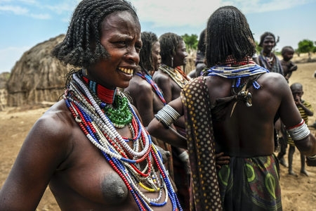 Omo Valley, Ethiopia, January 26: Unidentified women from Arbore tribe posing for a portrait with traditional jewelry in their village on January 26, 2018 in Omo valley, Ethiopia.