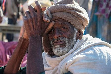 Hawzien, Tigray, Ethiopia - January 10: Portrait of an unidentified older man sitting in the Hawzien market on January 10, 2018 in Hawzien, Tigray region, Ethiopia.