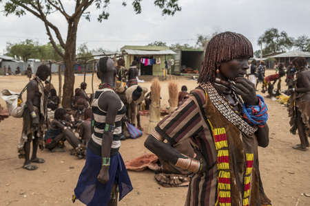 Turmi, Omo Valley, Ethiopia - January 25: Unidentified Hamer people at village market. Weekly markets are important events in Omo Valley tribal life on January 25, 2018 in Turmi, Ethiopia.