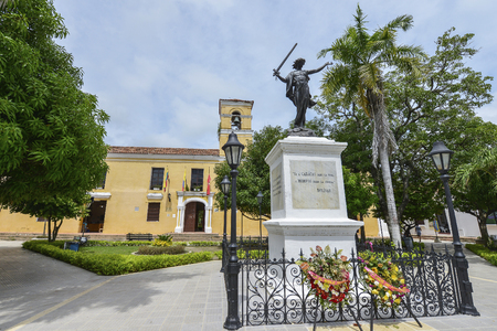 Mompox, Colombia - August 8: Statue of a freed slave in front of the San Carlos Palace on August 8, 2017 in Mompox, Colombia.