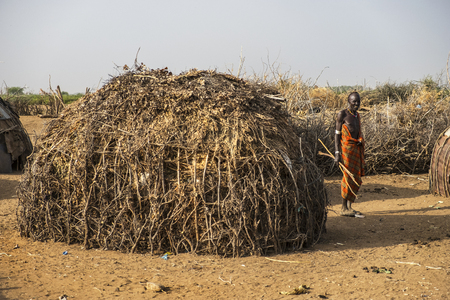 Omorate, Ethiopia - January 25: Unidentified man from the Dassanech tribe in his village next to his house on January 25, 2018 in Ethiopia. The Dassanech tribe lives between Omorate and Lake Turkana.