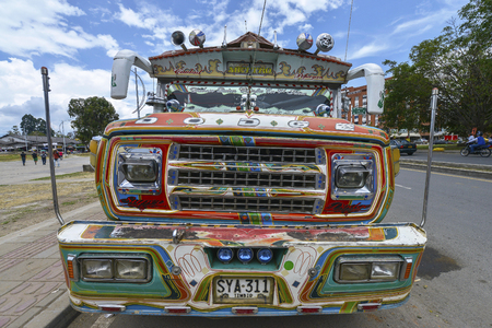 Popayan, Colombia - August, 18: Colorful bus, colloquially known as a chiva on August 18, 2017 in Popayan, Colombia.