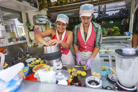 San Gil, Colombia - August 10: Unidentified women making juices in the San Gil market on August 10, 2017 in San Gil, Colombia. Editorial