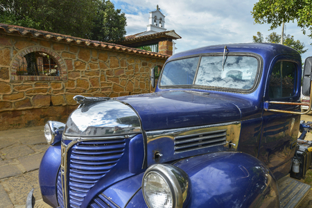 Barichara, Colombia - August 11: Vintage vehicle parked on a street on August 11, 2017 in the colonial Barichara, Colombia. Editorial