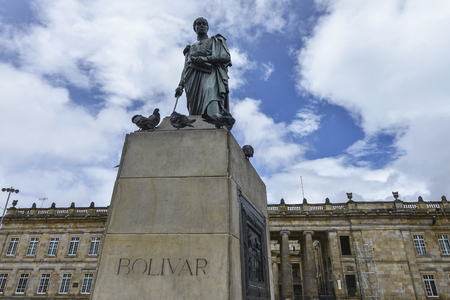 Statue of Simon Bolivar in the Bolivar square with the National Capitol in the background in Bogota, Colombia. Stock fotó