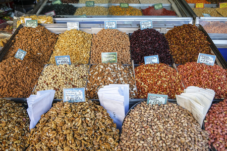 Assorted nuts for sale in the market with price signs written in Greek. Athens Greece.