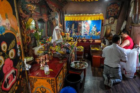 Gangtok, India - October 2020: Buddhist monk praying inside the Enchey Monastery on October 22, 2020 in Gangtok, Sikkim, India.
