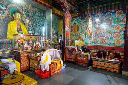 Gangtok, India - October 2020: Buddhist monks praying inside the Enchey Monastery on October 22, 2020 in Gangtok, Sikkim, India.