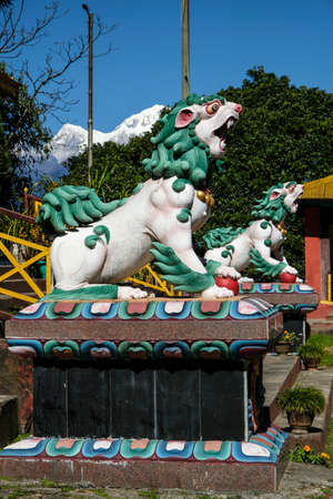 Pelling, India - October 2020: Statues of two lions in the Pemayangtse Monastery on October 30, 2020 in Pelling, Sikkim, India.