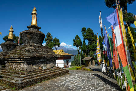 Pelling, India - October 2020: Prayer flags and stupas in the Buddhist Sanghak Choeling Monastery in Pelling on October 31, 2020 in Sikkim, India. Editorial