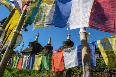 Prayer flags and stupas in the Buddhist Sanghak Choeling Monastery in Pelling Stock Photo