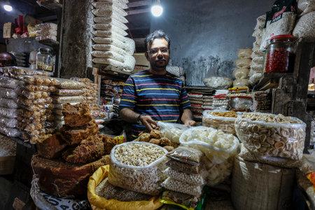 Tezpur, India - November 2020: Dried fruit seller in the Tezpur market on November 14, 2020 in Assam, India. Editorial