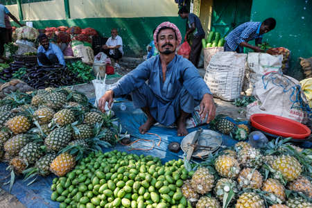 Tezpur, India - November 2020: Fruit seller in the Tezpur market on November 14, 2020 in Assam, India. Editorial