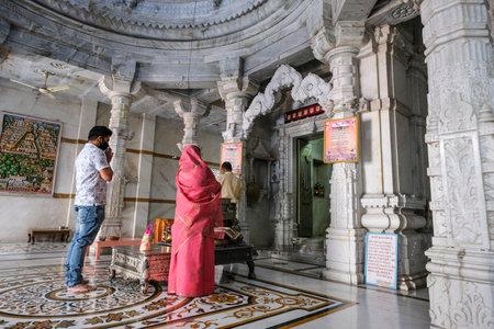 Tezpur, India - November 2020: People praying in the Shree Jain Swetamber Gauri Parswanath Temple in Tezpur on November 14, 2020 in Assam, India.