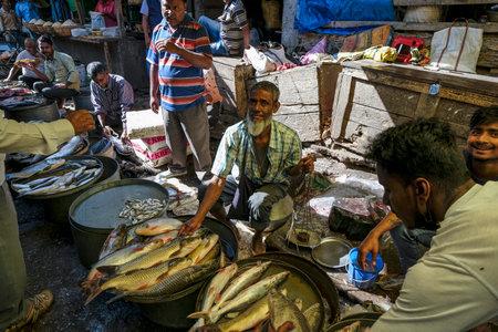 Tezpur, India - November 2020: Fish seller in the Tezpur market on November 14, 2020 in Assam, India.