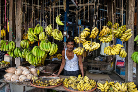 Tezpur, India - November 2020: Banana seller in the Tezpur market on November 14, 2020 in Assam, India. Editorial