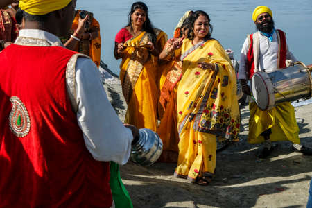 Dibrugarh, India - November 2020: A group of people making offerings, singing and dancing before celebrating a wedding on November 25, 2020 in Dibrugarh, Assam, India Editorial