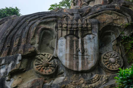 Sculptures carved into the rock at the archaeological site of Unakoti in the state of Tripura. India.