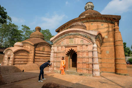 Udaipur, India - December 2020: A pilgrim taking photos in the Chaturdasa Devata Temple on December 18, 2020 in the city of Udaipur, the ancient capital of Tripura. India.