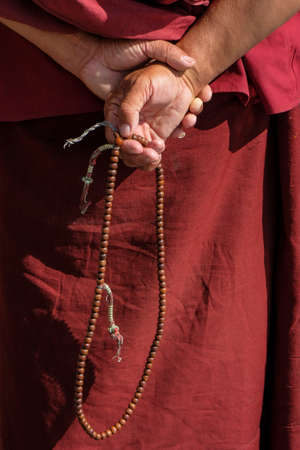 Detail of the hands of a Buddhist monk in the Tabo Monastery in Tabo village  in Spiti valley, Himachal Pradesh, India.