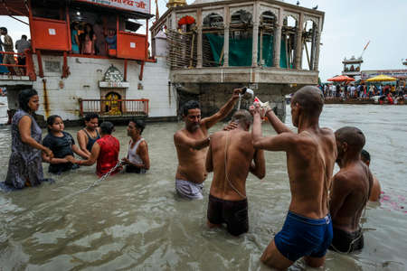 Haridwar, India - July 2021: Pilgrims bathing in the Ganges River at Haridwar on July 14, 2021 in Uttarakhand, India.