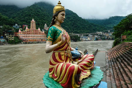 Rishikesh, India - July 2021: Views of the Swarg Niwas Temple from the Sai Ghat in Rishikesh on July 20, 2021 in Uttarakhand, India.