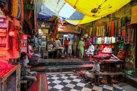 Delhi, India - August 2021: Market near the Dargah Hazrat Nizamuddin marble shrine is dedicated to the Sufi Muslim saint Nizamuddin Auliya on August 7, 2021 in Delhi, India.