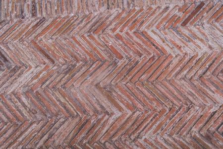 Diagonal red brick wall