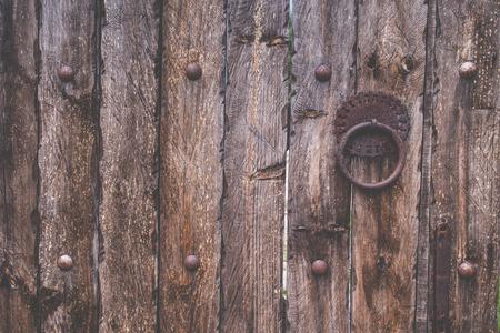 Old wood texture door with bolt
