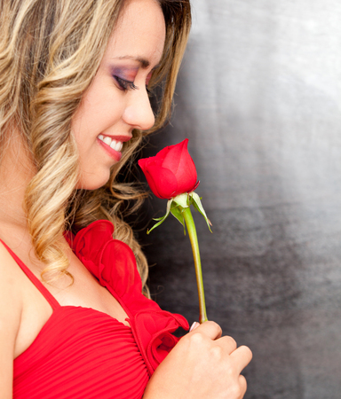Beautiful romantic woman with a red rose