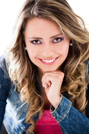 Beautiful casual woman smiling - isolated over a white background