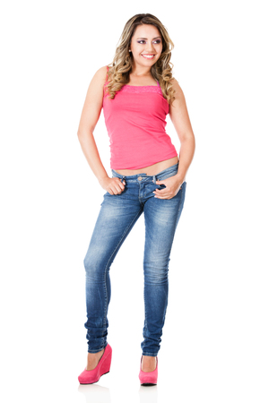 Beautiful woman posing for the camera and smiling - isolated