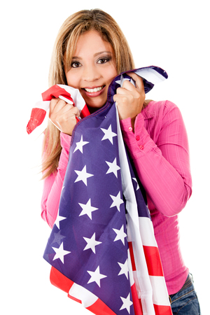 Beautiful woman holding an american flag smiling-Isolated Imagens