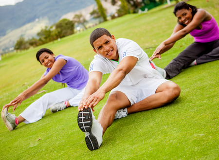 Group of people exercising at the park