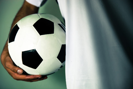 Soccer player holding a soccer ball Stock Photo
