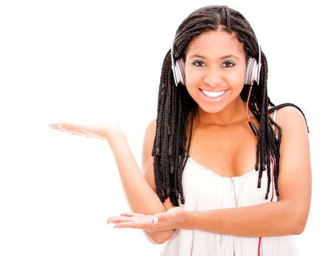 Beautiful black woman with headphones showing something with her hands Stock Photo