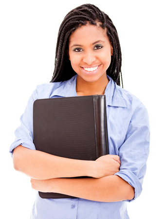 Beautiful African descemt smiling and holding a binder Stock Photo